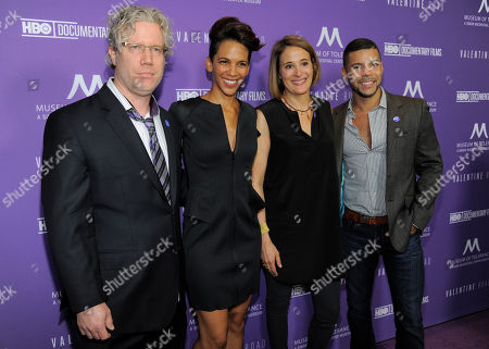 """Marta Cunningham, second from left, director of the documentary film """"Valentine Road,"""" poses with producers Eddie Schmidt, left, and Sasha Alpert, second from right, and actor Wilson Cruz, national spokesperson for GLAAD, at the premiere of the film at the Museum of Tolerance on in Los Angeles"""