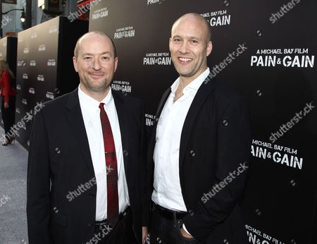 "Writers Christopher Markus, left, and Stephen McFeely arrives at the LA Premiere of ""Pain and Gain"" at the TCL Theatre on in Hollywood, Calif"