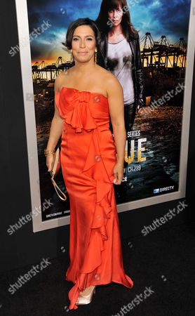 """Claudia Ferri, a cast member in """"Rogue,"""" poses at the Los Angeles premiere of the DirecTV original series at the ArcLight Hollywood on in Los Angeles"""