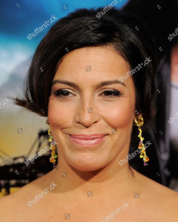 """Stock Image of Claudia Ferri, a cast member in """"Rogue,"""" poses at the Los Angeles premiere of the DirecTV original series at the ArcLight Hollywood on in Los Angeles"""