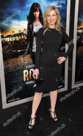 """Stock Photo of Patty Ishimoto, Vice President, Entertainment, and GM, Audience Network & n3D at DirecTV, poses at the Los Angeles premiere of the DirecTV original series """"Rogue"""" at the ArcLight Hollywood on in Los Angeles"""