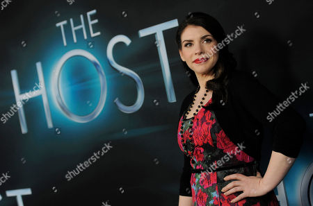 """Stock Picture of Stephanie Meyer, producer of the film """"The Host,"""" as well as author of the novel upon which it is based, poses at the Los Angeles premiere of film at the ArcLight Hollywood on in Los Angeles"""