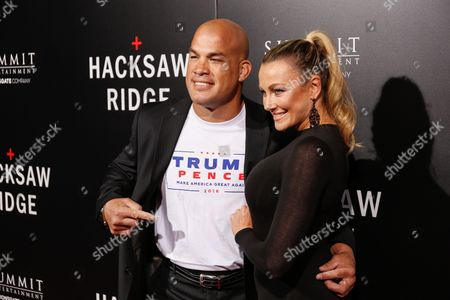 """Fighter Tito Ortiz, left, and Amber Nicole Miller arrive at the LA Special Screening of """"Hacksaw Ridge"""" at the Samuel Goldwyn Theater, in Beverly Hills, Calif"""