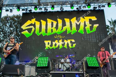 From left, Rome Ramirez, Josh Freese, and Eric Wilson of Sublime with Rome perform on stage during the Made In America Festival at Grand Park, in Los Angeles, Calif