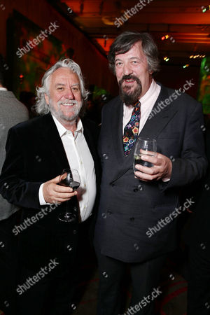 Stock Image of Production designer Dan Hennah and Stephen Fry seen at New Line Cinema Premiere of 'The Hobbit: The Desolation of Smaug', held at the Dolby Theatre on in Los Angeles