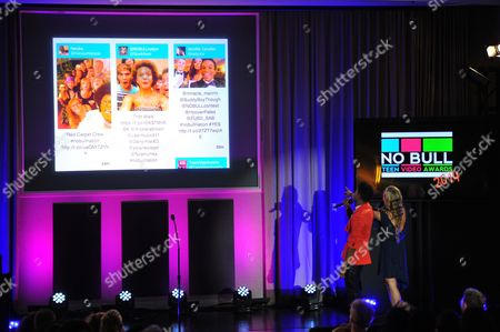 Show hosts Nadji Jeter (L) and Nicole Edgington are seen watching a live social media feed at the No Bull 2014 Teen Video Awards at The Westin Hotel on in Los Angeles, California