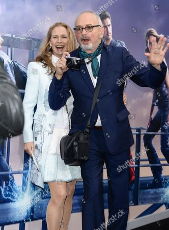 """Fashion photographer Arthur Elgort and wife Grethe Barrett Holby attend the premiere of """"Allegiant"""" at AMC Lincoln Square, in New York"""