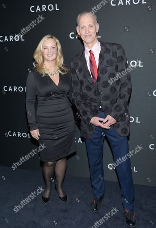 """Patricia Hearst, left, and John Waters arrive at the premiere of """"Carol"""" at the Museum of Modern Art, in New York"""