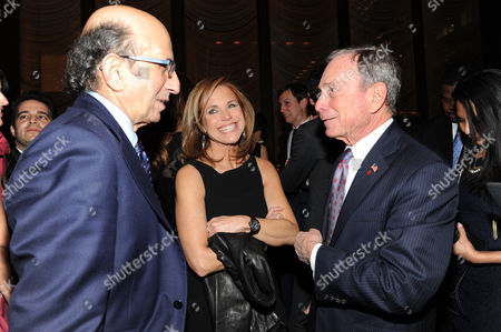 Joel Klein, left, Katie Couric and New York Mayor Michael Bloomberg attend The New York Observer's 25th anniversary party at The Four Seasons Restaurant on in New York
