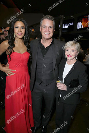 Stock Photo of Kali Hawk, Stuart Ford, founder and chief executive officer of IM Global, and Florence Henderson seen at Open Road Films Premiere of 'Fifty Shades of Black' at Regal L.A. Live, in Los Angeles, CA