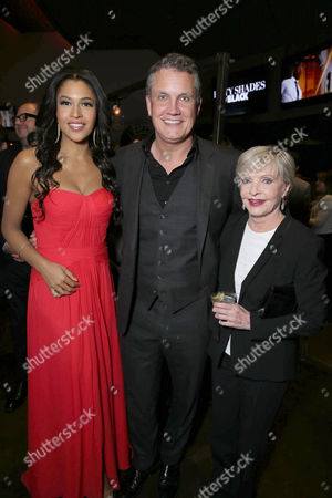Kali Hawk, Stuart Ford, founder and chief executive officer of IM Global, and Florence Henderson seen at Open Road Films Premiere of 'Fifty Shades of Black' at Regal L.A. Live, in Los Angeles, CA