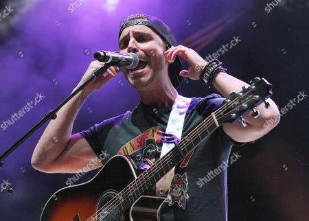 American Idol winner, Nick Fradiani performs during the Q100 Moon Shine Grind at Verizon Wireless Amphitheatre at Encore Park, in Alpharetta