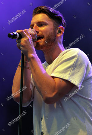 Marc E. Bassy performs during the Q100 Moon Shine Grind at Verizon Wireless Amphitheatre at Encore Park, in Alpharetta