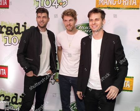 Stock Image of Cubbie Fink, from left, Mark Pontius and Mark Foster of the band Foster the People pose for photographers backstage during the Radio 104.5 Birthday Show at the Susquehanna Bank Center, in Camden, N.J