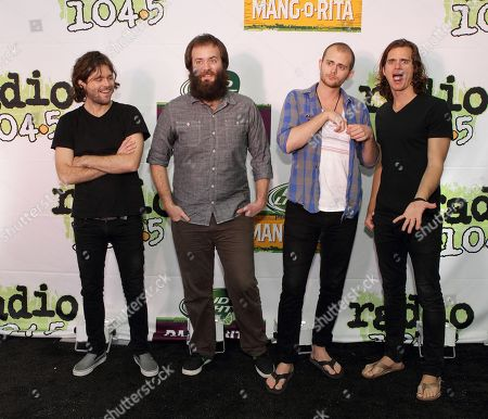 Jesse Kongos, from left, Johnny Kongos, Daniel Kongos and Dylan Kongos of the band Kongos pose for photographers backstage during the Radio 104.5 7th Birthday Show at the Susquehanna Bank Center, in Camden, N.J