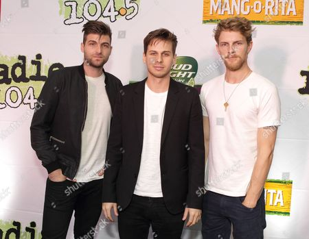 Stock Picture of Cubbie Fink, from left, Mark Foster and Mark Pontius of the band Foster the People pose for photographers backstage during the Radio 104.5 Birthday Show at the Susquehanna Bank Center, in Camden, N.J
