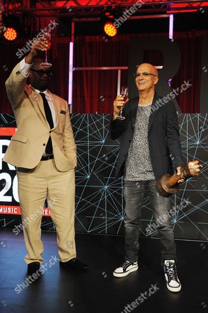 Andre Harrell and Jimmy Iovine appear during the REVOLT Music Conference Gala Dinner at Fontainebleau Miami Beach, in Miami Beach, Fla