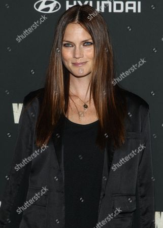 """Model Mini Anden arrives at the season 4 premiere of """"The Walking Dead"""" at the AMC Universal Citywalk Stadium 19/IMAX on in Universal City, Calif"""