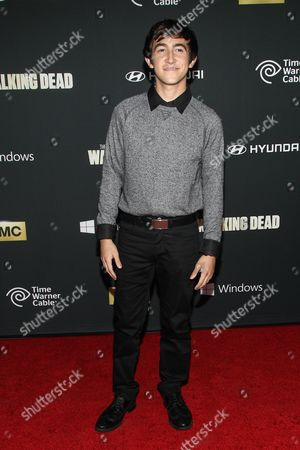 """Actor Vincent Martella arrives at the season 4 premiere of """"The Walking Dead"""" at the AMC Universal Citywalk Stadium 19/IMAX on in Universal City, Calif"""