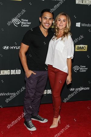 "Actors Carlos Pena, Jr. and Alexa Vega arrive at the season 4 premiere of ""The Walking Dead"" at the AMC Universal Citywalk Stadium 19/IMAX on in Universal City, Calif"