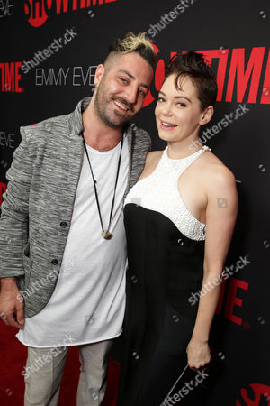 Davey Detail and Rose McGowan seen at Showtime's 2014 Emmy Eve Soiree held at the Sunset Tower Hotel, in Los Angeles