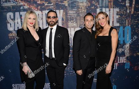 A.J. Mclean and wife Rochelle Deanna Karidis pose with Howie Dorough and his wife Leigh Boniello at the SNL 40th Anniversary Special at Rockefeller Plaza, in New York