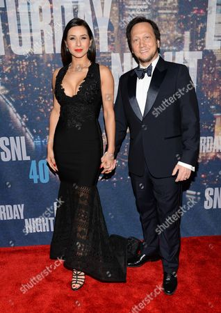Rob Schneider and wife Patricia Azarcoya Arce attend the SNL 40th Anniversary Special at Rockefeller Plaza, in New York