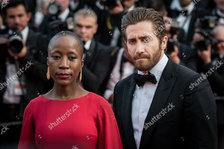 Rokia Traore and Jake Gyllenhaal arrive for the opening ceremony and for the screening of the film La Tete Haute (Standing Tall) at the 68th international film festival, Cannes, southern France