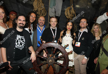 """From left, Bear McCreary, Zach McGowan, Mark Ryan, Jonathan Steinberg, Jessica Parker Kennedy, and Robert Levine pose for a photo at the Starz' """"Black Sails"""" booth during San Diego Comic-Con on in San Diego, Calif. """"Black Sails"""" premieres on STARZ January 2014"""