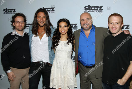 """From left, Robert Levine, Zach McGowan, Jessica Parker Kennedy, Mark Ryan, and Jonathan Steinberg pose for a photo on the press line for Starz' """"Black Sails"""" during San Diego Comic-Con on in San Diego, Calif. """"Black Sails"""" premieres on STARZ January 2014"""