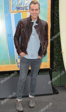 """Stock Image of William Loftis attends the """"Teen Beach Movie"""" screening e at event at The Walt Disney studios on in Burbank, Calif"""