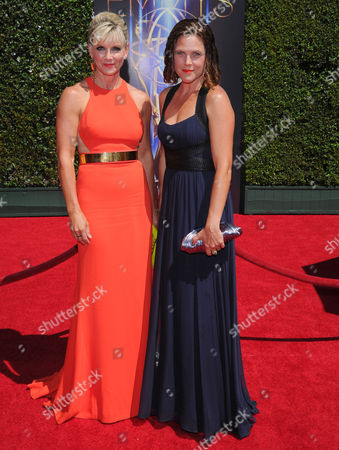 Karen Moyer and Irene Taylor Brodsky arrive at the Television Academy's Creative Arts Emmy Awards at the Nokia Theater L.A. LIVE, in Los Angeles
