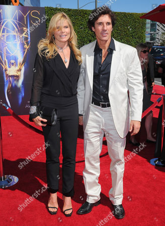 Mariel Hemingway, left, and Bobby Williams arrives at the Television Academy's Creative Arts Emmy Awards at the Nokia Theater L.A. LIVE, in Los Angeles
