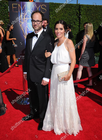 Stock Photo of Alex DiGerlando, left, arrives at the Television Academy's Creative Arts Emmy Awards at the Nokia Theater L.A. LIVE, in Los Angeles