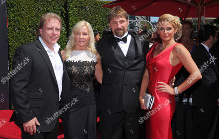 Sig Hansen, left, and guest, Johnathan Hillstrand and guest, arrive at the Television Academy's Creative Arts Emmy Awards at the Nokia Theater L.A. LIVE, in Los Angeles