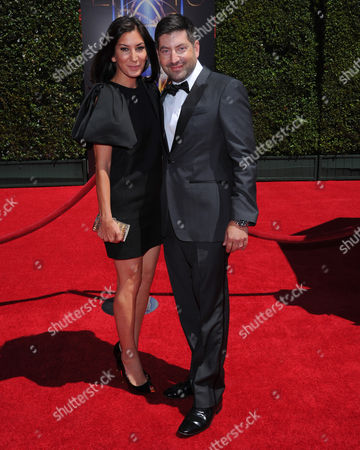 Suzann Levine, left, and James S. Levine arrive at the Television Academy's Creative Arts Emmy Awards at the Nokia Theater L.A. LIVE, in Los Angeles