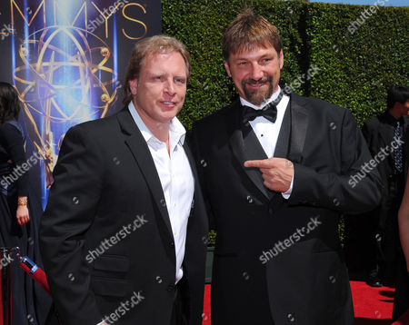 Sig Hansen, left, and Johnathan Hillstrand arrive at the Television Academy's Creative Arts Emmy Awards at the Nokia Theater L.A. LIVE, in Los Angeles