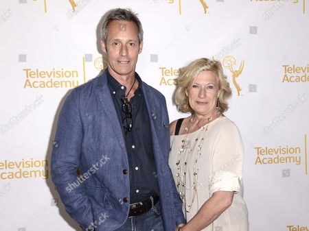 Michel Gill, left, and Jayne Atkinson arrive at the Television Academy's 66th Emmy Awards Producers Nominee Reception at the London West Hollywood on