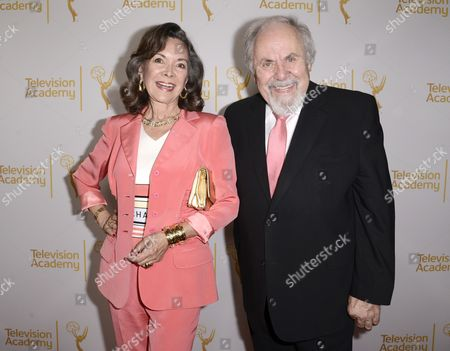Jolene Brand, left, and George Schlatter arrive at the Television Academy's 66th Emmy Awards Producers Nominee Reception at the London West Hollywood on