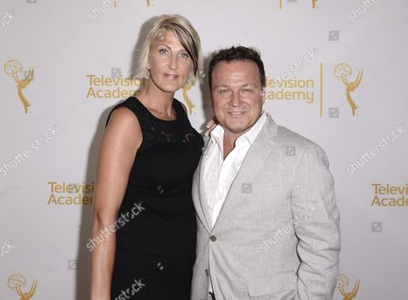 Christine Oakes, left, and Chad Oakes arrive at the Television Academy's 66th Emmy Awards Producers Nominee Reception at the London West Hollywood on