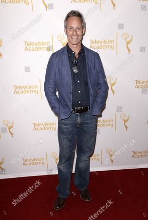 Michel Gill arrives at the Television Academy's 66th Emmy Awards Producers Nominee Reception at the London West Hollywood on