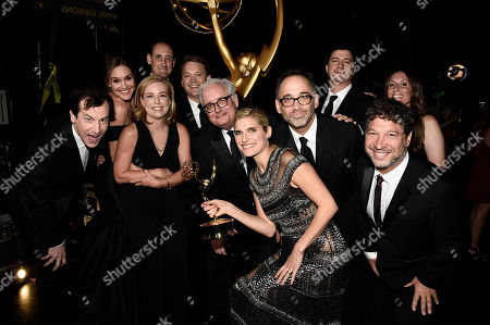 """Stock Picture of Rob Huebel, from left, Erinn Hayes, Zandy Hartig, Krister Johnson, Keith Crofford, Lake Bell, Davis Wain, Ken Morino, Jonathan Stern, and team, winners of the award for for outstanding short form comedy or drama series for """"Children's Hospital"""" attend night two of the Television Academy's 2016 Creative Arts Emmy Awards at the Microsoft Theater on in Los Angeles"""