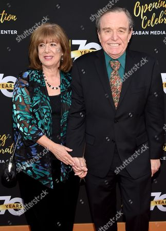 Teresa Modnick, left, and Jerry Mathers arrive at the Television Academy's 70th Anniversary Gala and Opening Celebration for its new Saban Media Center, in the NoHo Arts District in Los Angeles