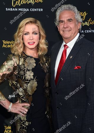 Donna Mills, left, and Larry Gilman arrive at the Television Academy's 70th Anniversary Gala and Opening Celebration for its new Saban Media Center, in the NoHo Arts District in Los Angeles