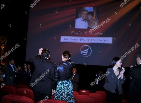 Haim Saban, left, and Cheryl Saban are acknowledged at the Television Academy's 70th Anniversary Gala and Opening Celebration for its new Saban Media Center, in the NoHo Arts District in Los Angeles