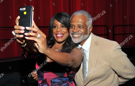 Niecy Nash, left, and Ted Lange take a selfie at the Television Academy's 70th Anniversary Gala and Opening Celebration for its new Saban Media Center, in the NoHo Arts District in Los Angeles