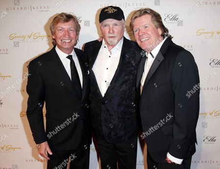 Nigel Lythgoe, left, Mike Love, center, and Peter Noone pose together at The Society of Singers' 21st ELLA Awards on in Beverly Hills, Calif. The event honored Mike Love, lead singer and co-founder of The Beach Boys, producer Nigel Lythgoe, and backup singers The Waters Family