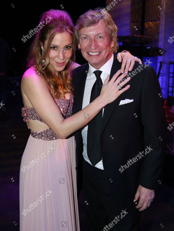 Stock Image of Nigel Lyhtgoe, right, and Becky Baeling Lythgoe pose together at The Society of Singers' 21st ELLA Awards on in Beverly Hills, Calif. The event honored Mike Love, lead singer and co-founder of The Beach Boys, producer Nigel Lythgoe, and backup singers The Waters Family
