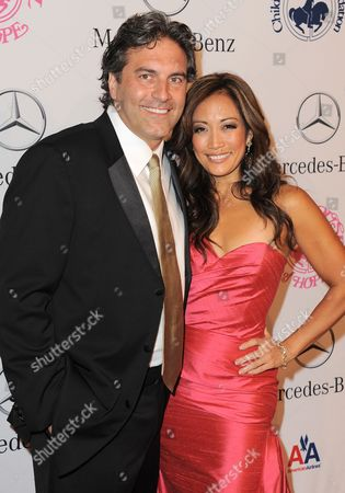 Stock Image of Jesse Sloan and Carrie Ann Inaba arrive at The Carousel of Hope at The Beverly Hilton Hotel, in Beverly Hills