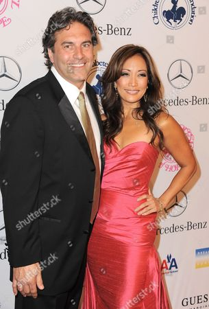 Stock Photo of Jesse Sloan and Carrie Ann Inaba arrive at The Carousel of Hope at The Beverly Hilton Hotel, in Beverly Hills
